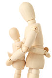 Wooden figures of parent embracing child Royalty Free Stock Photos