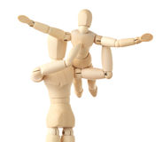 Wooden figures parent holding his child on hands royalty free stock photo