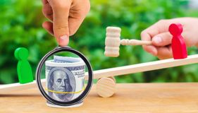 Wooden figures of people on scales and dollars between them. a d. Ispute between two businessmen. trial. debt restructuring. wage arrears. protection of employee stock image
