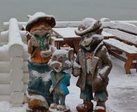 Wooden figures at the winter day. Fox, cat and mouse royalty free stock photo