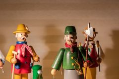 Wooden figures standing on a shelf. Nutcracker , christmas, symbol; royalty free stock photo