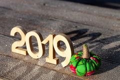 Wooden figures 2019 on a wooden frozen background. Happy New Yea