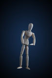 Wooden figurine flexing muscles in bodybuilder pose on dark back Stock Image