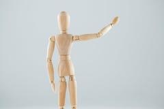 Wooden figurine hailing Royalty Free Stock Photo