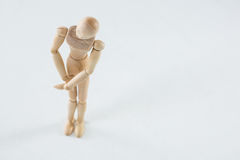 Wooden figurine with leg injured. Against white background royalty free stock photos