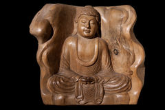 Wooden Figurine Of Meditating Buddha Stock Photo