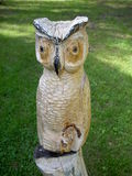 Wooden figurine of an owl. On green grass background Royalty Free Stock Photography