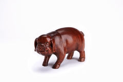 Wooden figurine of a pig. Executed by woodcarving Stock Photos