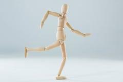 Wooden figurine running Stock Photography