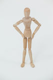Wooden figurine standing with hands on hips Stock Photos