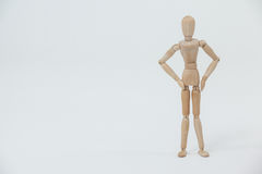 Wooden figurine standing with hands on hips Royalty Free Stock Photos