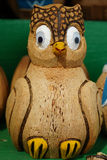 Wooden figurine toy owl. With green background Royalty Free Stock Image