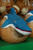 Wooden figurine toy shark. Wooden figurine toy blue shark royalty free stock image