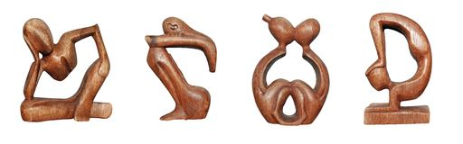 Wooden figurines. This is series of mahogany wooden figurines royalty free stock photos