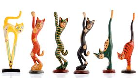 Wooden figurines, decorative figurines, cats,. Isolated on a white background Stock Image
