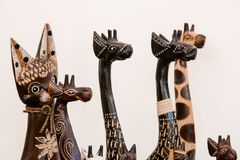 Wooden figurines in the form of giraffes and cats royalty free stock photography