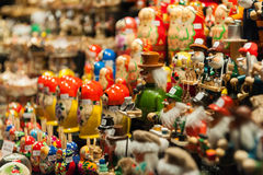 Wooden figurines. Set of colorful figurines displayed at the street market at Christmastime Stock Photos