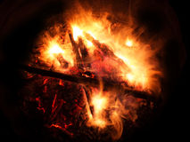 Wooden fire burning on a dark background. Wooden fire with coals burning on a dark background Royalty Free Stock Image