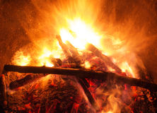 Wooden fire with coals burning. On a dark background Royalty Free Stock Photos