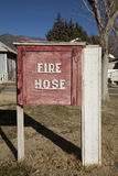 Wooden Fire Hose box. A red wooden fire hose box Royalty Free Stock Image