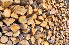 Wooden fire wood logs in a pile Royalty Free Stock Photos