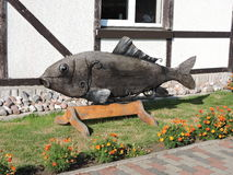 Wooden fish-sculpture Stock Images
