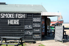 Wooden fish shop on beach. Wooden fish shop at Aldeburgh with chalk signs Royalty Free Stock Photo