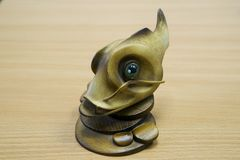 Wooden fish statuette. On the table. Souvenir Royalty Free Stock Photos
