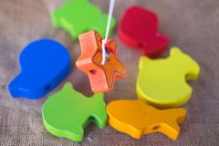 Wooden fish toy for kids. On the table Royalty Free Stock Photography