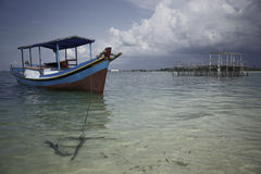 Wooden fisher boat on indonesian sea Royalty Free Stock Photo