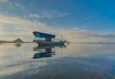 A wooden fisherman boat at the morning of sunrise. Stock Image