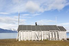 Wooden fisherman`s hut lies in a fjord in Spitzbergen. Norway Stock Image