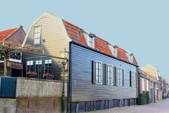 Characteristic timber fisherman houses,Spakenburg,Netherlands. Traditional ancient wooden fisherman houses along the old harbour of fishing village Spakenburg Royalty Free Stock Photography