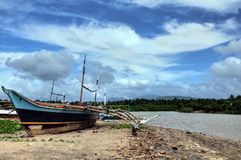 Wooden Fishing Boat. A fishing boat lying idle on a Philippine beach Royalty Free Stock Photos