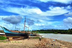 Wooden Fishing Boat. A fishing boat lying idle on a Philippine beach Stock Images