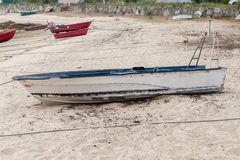 Wooden fishing boat anchored stock photo