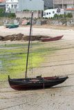 Wooden fishing boat anchored royalty free stock images