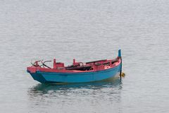 Wooden fishing boat anchored stock photography
