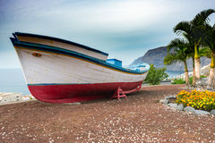 Wooden fishing boat as decoration of coastline of Tenerife island, Spain Royalty Free Stock Photo