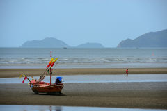 Wooden fishing boat on beach Stock Photos