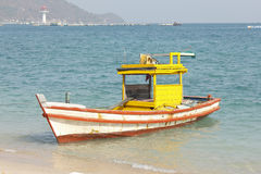 Wooden fishing boat on the beach. Royalty Free Stock Photo