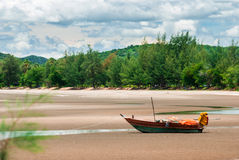 Wooden fishing boat on the beach. Stock Images
