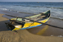 Wooden fishing boat on Bengal sea  beach  in Tamilnadu, India Royalty Free Stock Image