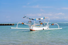 Wooden fishing boat in the blue sea Stock Photography