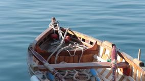 Wooden Fishing Boat. In the coast line stock footage