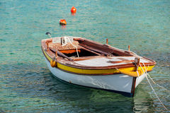 Wooden fishing boat floats in Adriatic sea Royalty Free Stock Photos