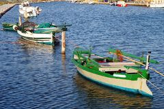Wooden Fishing Boat, Lefkada Greek Island, Greece. Colourful traditional wooden fishing boat in the lagoon or inner harbour, Lefkada, an Ionian Greek Island, at stock photography