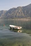 Wooden fishing boat in Montenegro mountains in the background Stock Photos