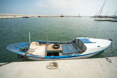 Wooden fishing boat on the pier Sarafovo in Bourgas, Bulgaria. Burgas - the regional center in Bulgaria, a major seaport on the Black Sea. Modern and historic Royalty Free Stock Photography