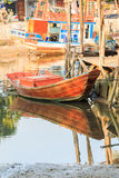 Wooden fishing boat with reflection Royalty Free Stock Images